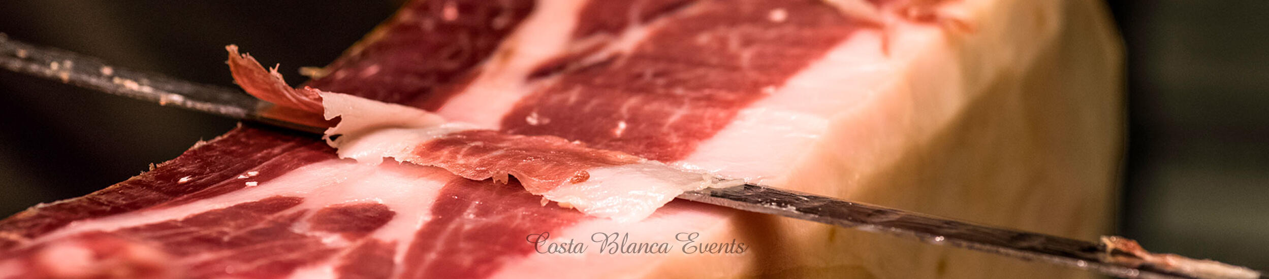 Spanish ham being cut s just unforgettable during a wedding in Spain