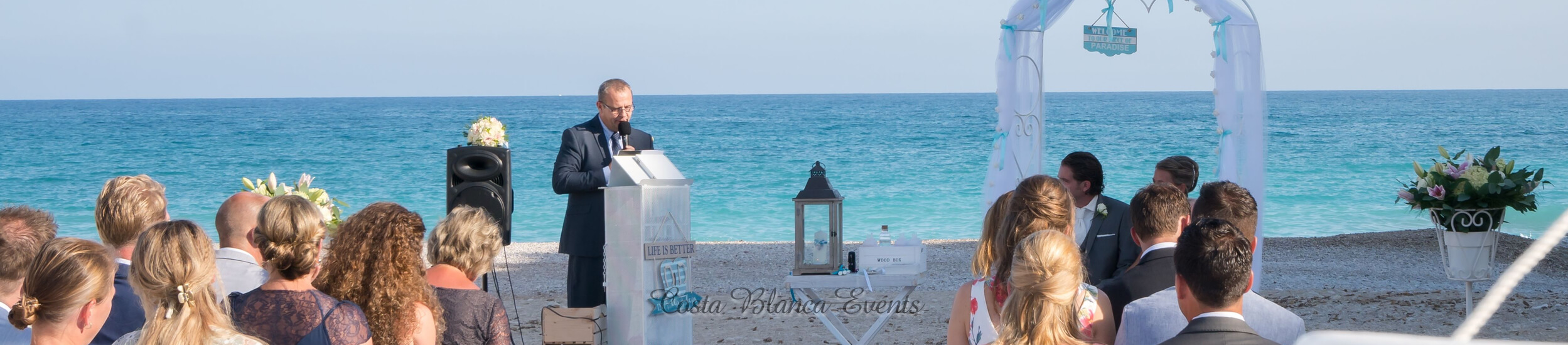 Photo of a ceremony of a couple getting married in Spain on the beach