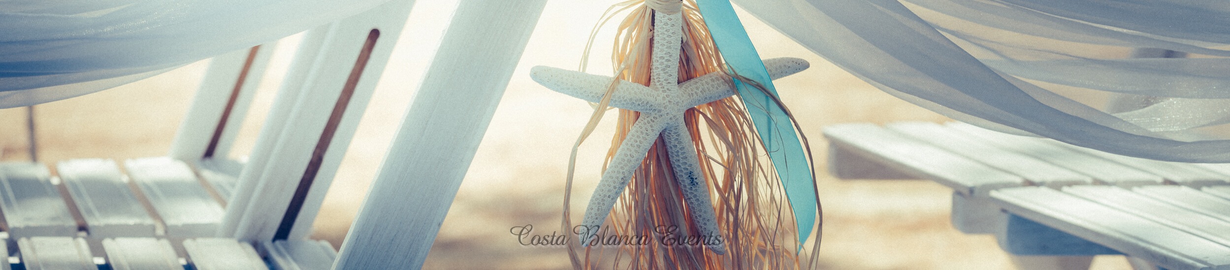 Detail of beach theme chair decoration with starfish