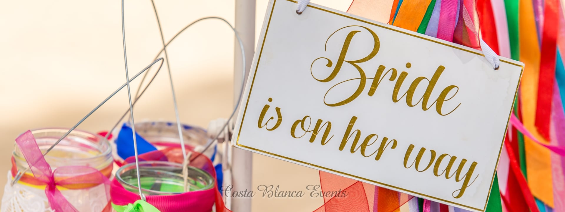 Photo of a sign with bride is on her way as part of the decoration for her marriage abroad