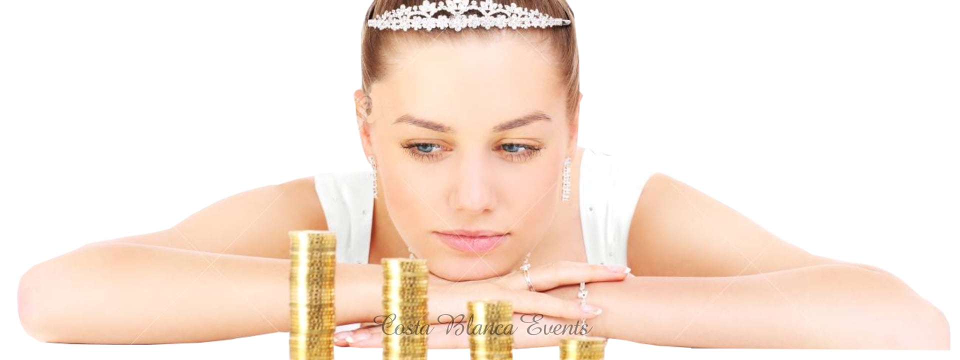 Photo of a Bride looking at a stack of coins when making a budget for her wedding in Spain